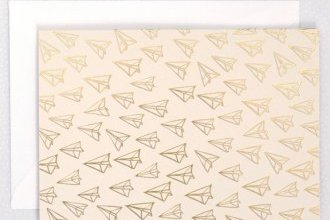 blank blush card with gold foil paper airplanes