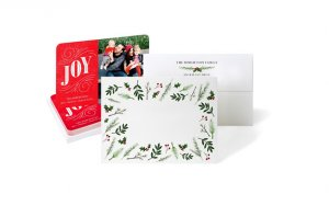 joy red Christmas photo card with back of card design with green leaves and mistletoe and back of card design