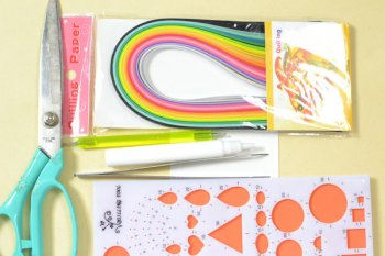 Materials and tools in making the new year quilling paper card: