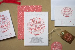 white wedding invitations with flowery red type