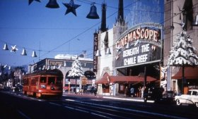 With an old LA Red Car trolley giving it a touch of holiday color, Graumans Chinese Theater on Hollywood Boulevard at Christmas time, 1953. (privatelosangelestours.com)